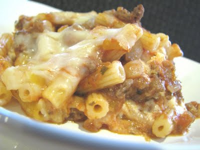 A serving of cheesy stuffed baked ziti on a white plate