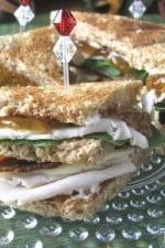 A plate full of Turkey Club Sandwiches