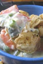A bowl of Chicken Pot Pie Soup with Puffy Croutons