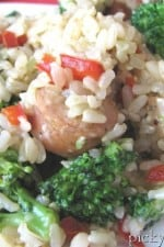 Chicken Sausage, Broccoli, Parmesan, and Brown Rice Dinner on a plate with a fork.