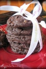 A stack of Chocolate Fudge Butterfinger Cookies wrapped in a ribbon.