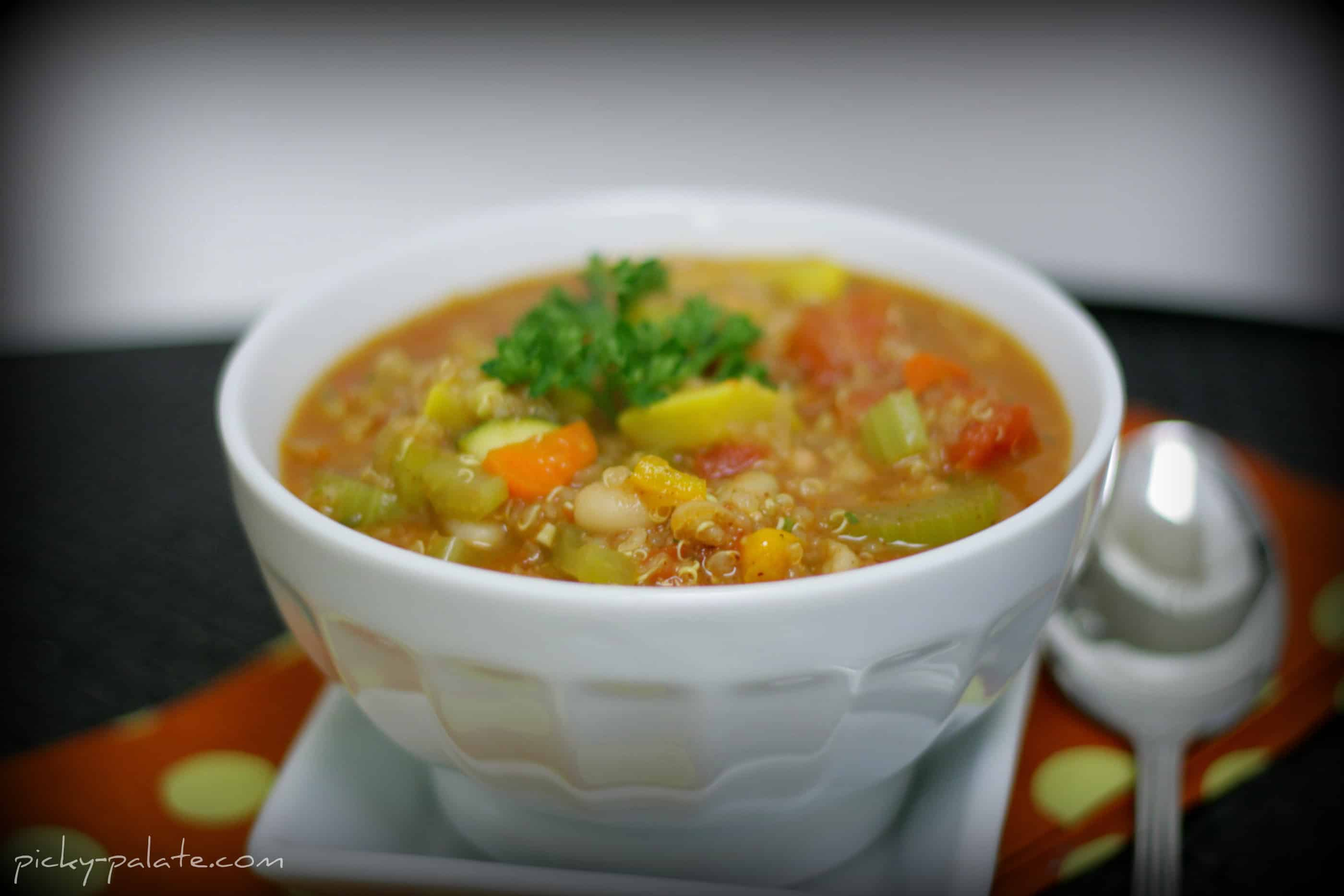 A bowl of Chunky Vegetable Quinoa Chili with a spoon.