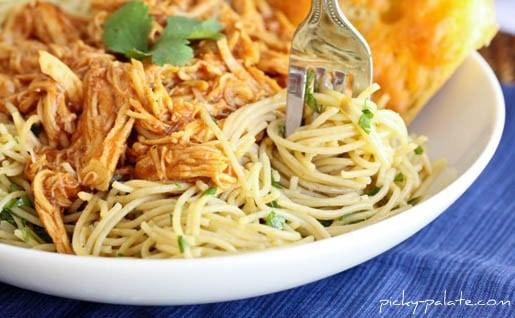 A Bowl of BBQ Chicken Spaghetti on a Blue Cloth Placemat