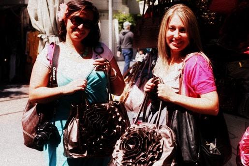 Mandy and Jenny Holding Handbags from the Kiosk
