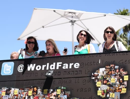 Four Women Posing by the World Fare Food Truck Sign