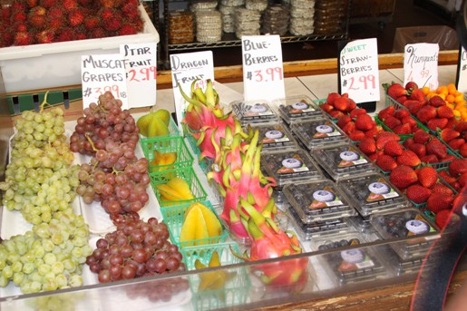 A Fruit Stand with Grapes, Strawberries and More at the Los Angeles Farmer's Market
