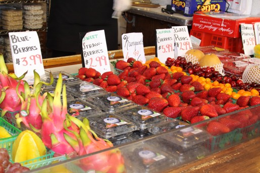 A Farmer's Market Fruit Stand with Blueberries, Pears, Cherries and Other Fruits