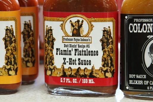 A Jar of Flamin' Flatulence Extra Hot Sauce on a Shelf
