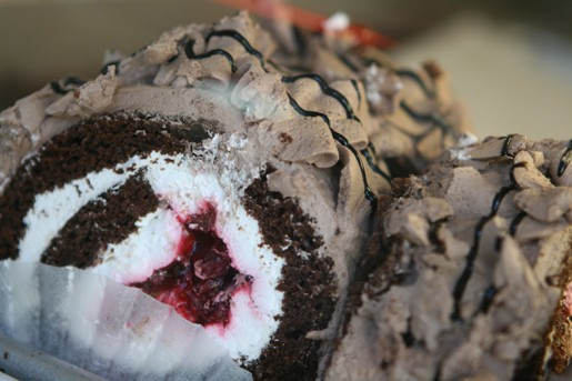 Two Homemade Chocolate and Vanilla Swiss Rolls Filled with Jam