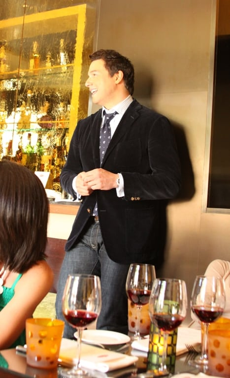Rocco DiSpirito Leaning Against a Wall in the Culina Restaurant