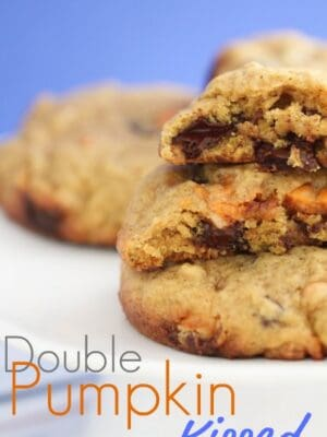 A few Double Pumpkin Kissed Chocolate Chunk Cookies in stacked.
