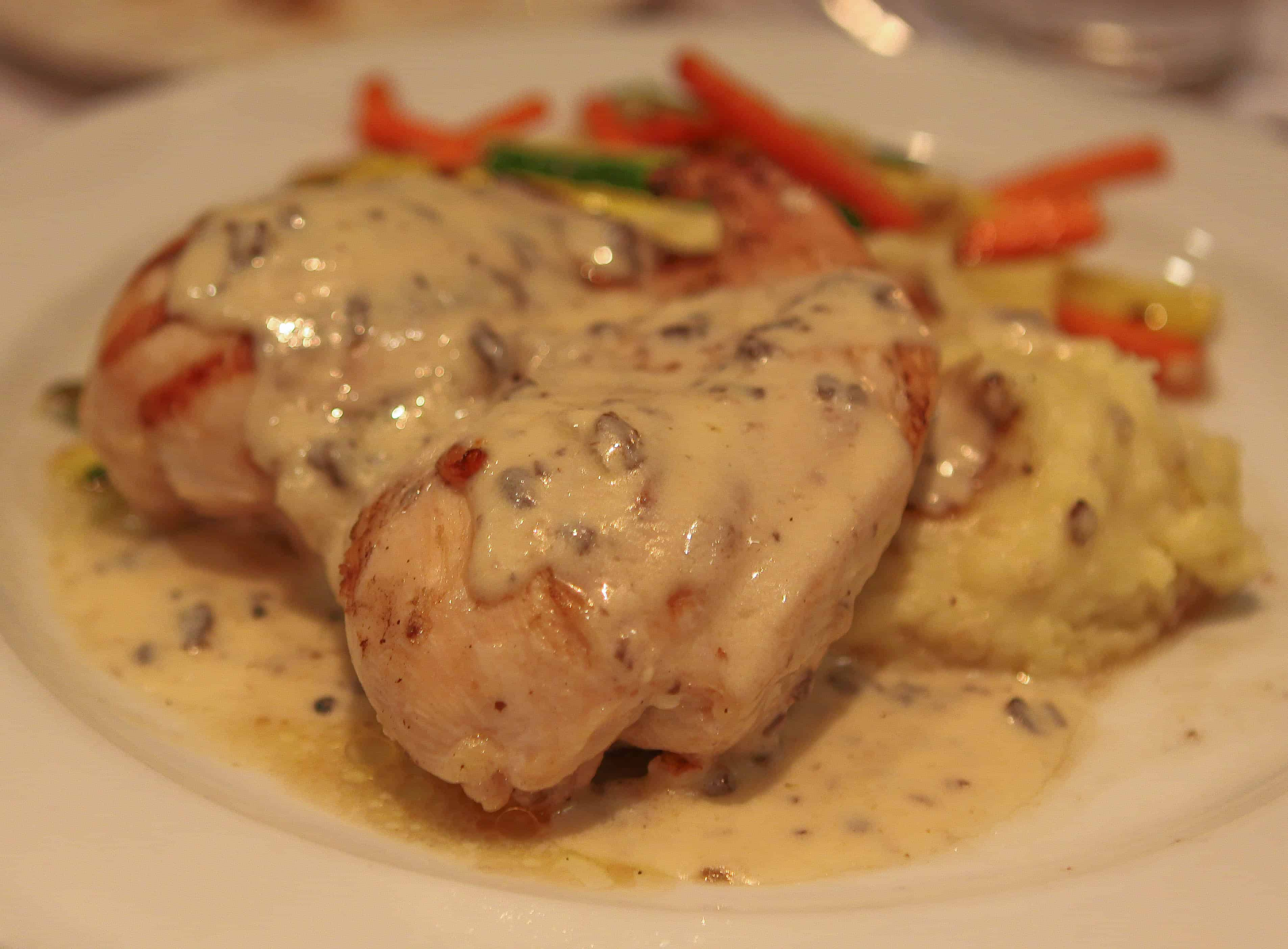 A Plate of Stuffed Chicken Breast with Blue Cheese and Mushrooms