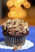 Chocolate mousse filled cupcake topped with crumbled Snickers candy