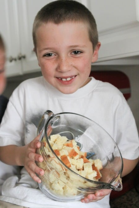 Image of My Son Holding the Bowl of Bread Cubes
