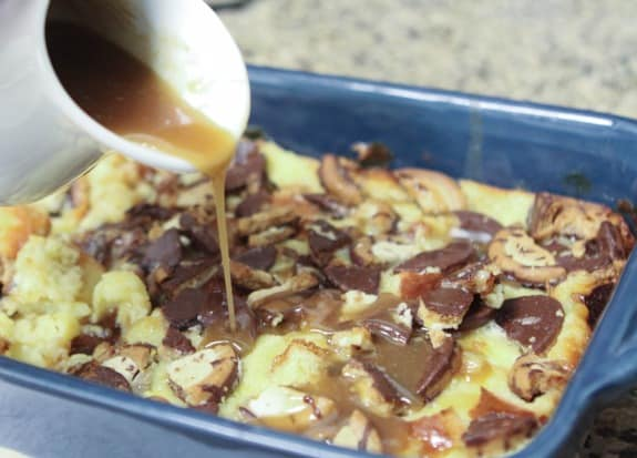 Image of Caramel Sauce Drizzling Over Cheesecake Cookie Bread Pudding