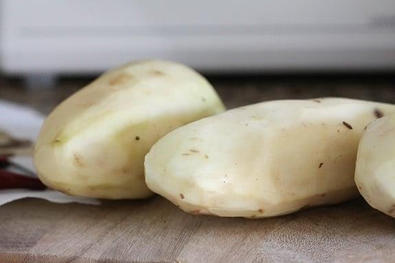 Skinned Potatoes on a Cutting Board