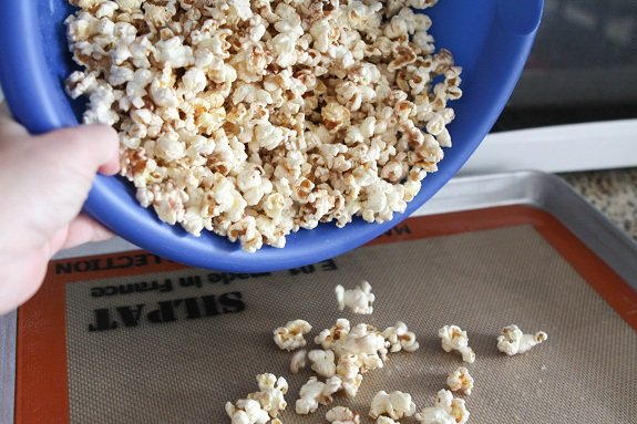Pouring Popcorn onto a Baking Sheet
