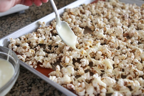 Drizzling White Chocolate Over Snickerdoodle Popcorn