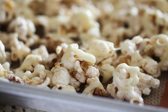 Snickerdoodle Popcorn with White Chocolate Drizzle on a Baking Sheet