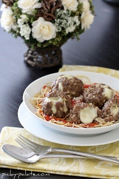 Mozzarella Stuffed Meatballs on Pasta