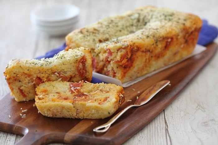 Cheesy Pepperoni Pizza Quick Bread with Two Slices Cut Out