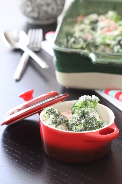 A Serving of Creamy Bacon and Roasted Red Pepper Broccoli Bake in a Dish
