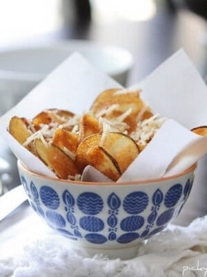 A Paper Towel Lined Bowl of Homemade Parmesan Potato Chips
