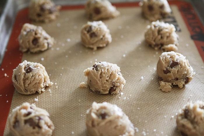 Brown Butter and Fleur de Sel Chocolate Chip Cookies Dough Balls on a Baking Sheet