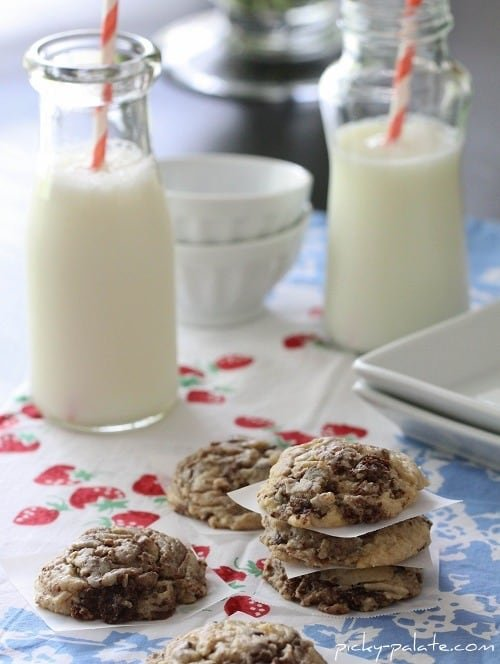 Image of Brownie Chunk Chocolate Chip Cookies with Two Glasses of Milk