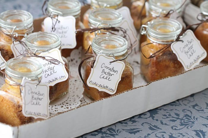 A Box Filled With Cinna-Bun Butter Cakes in a Jar
