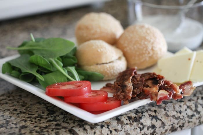 Image of Burger Buns and Toppings on a Plate