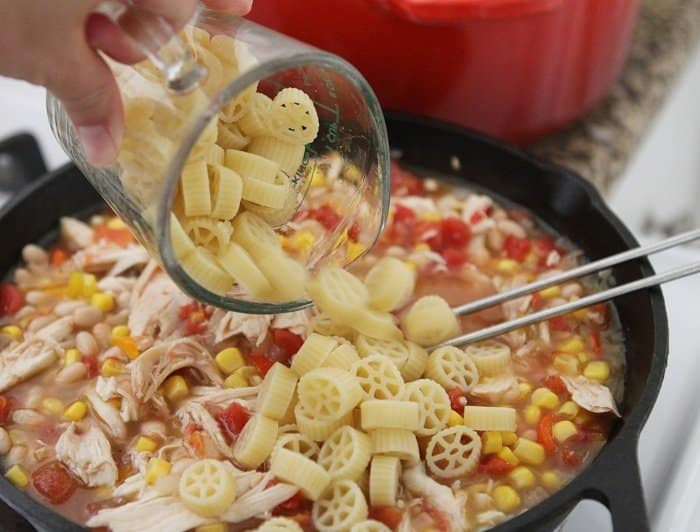 Image of Noodles Being Added to Southwest Chicken Chili Mac