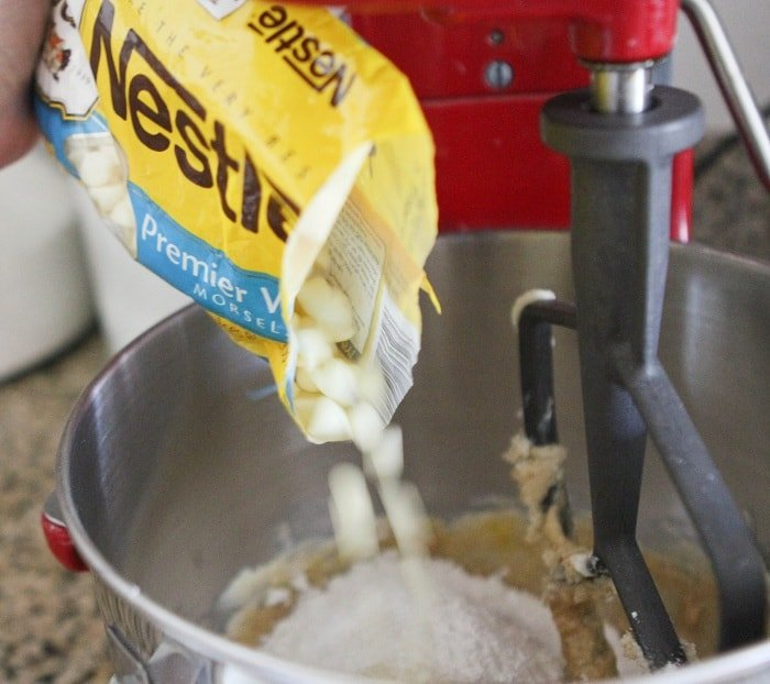Image of White Chocolate Chips Being Added to Cookie Dough