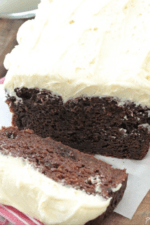 Image of a Double Chocolate Pumpkin Cake with Pumpkin Spice Buttercream Being Sliced