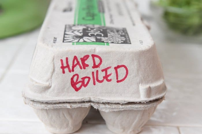 """An egg carton with the words """"hard boiled"""""""