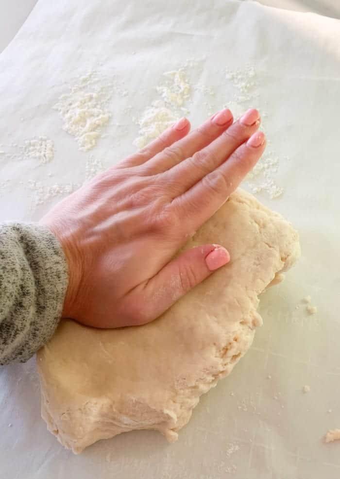 preparing dough for pie crust recipe