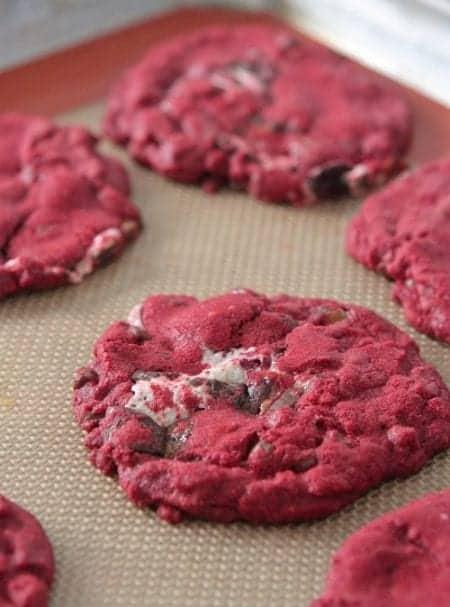 Gooey Red Velvet Milky Way Cake Cookies on a Baking Sheet