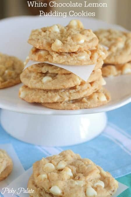 White Chocolate Lemon Pudding Cookies Stacked on a Cake Stand