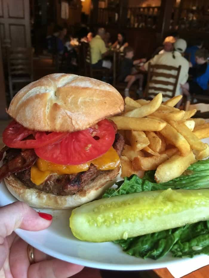A Plate Holding a Liberty Tree Tavern Burger and Sides
