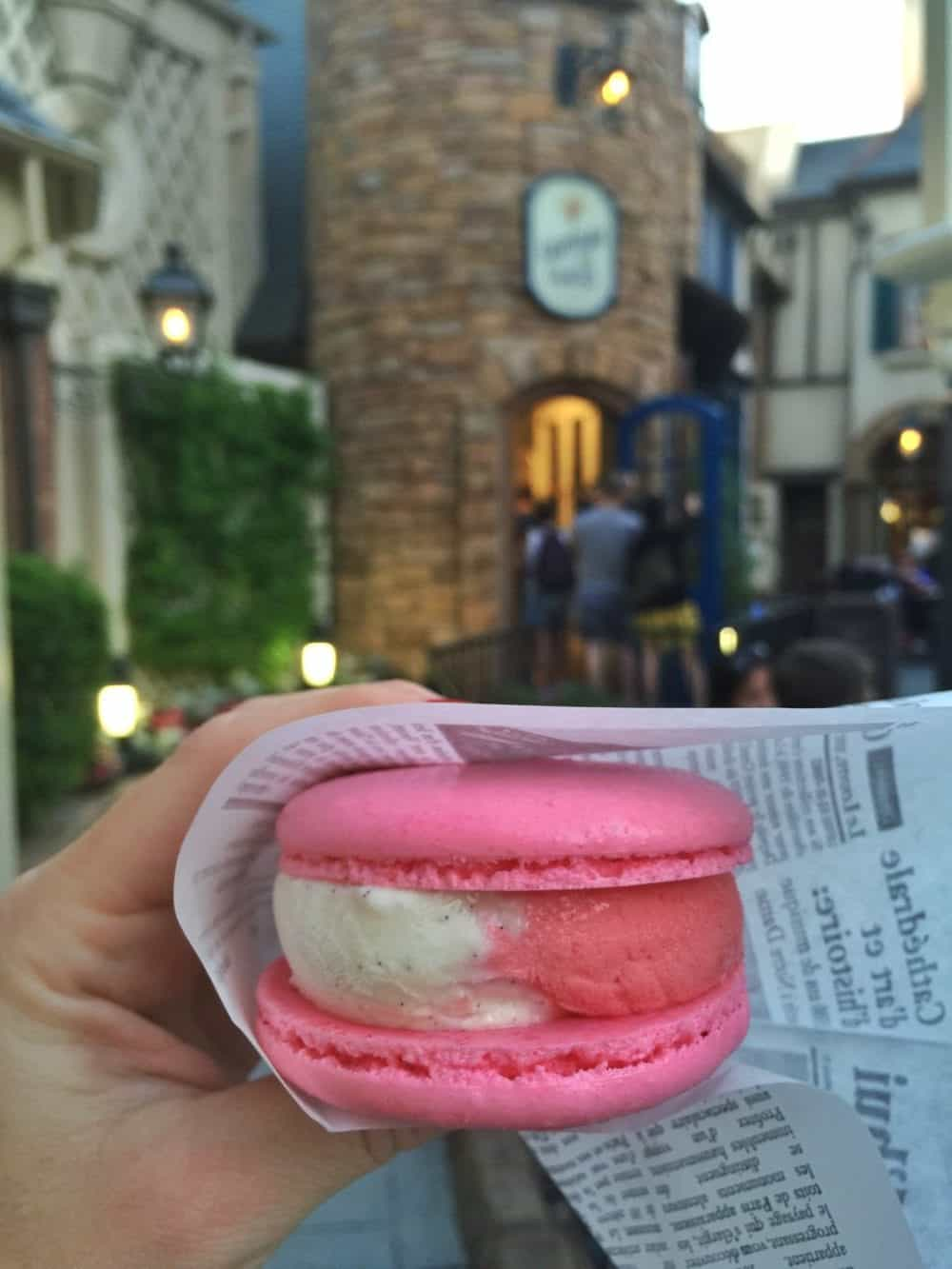A Pink Macaron Ice Cream Sandwich with Pink and White Ice Cream Inside