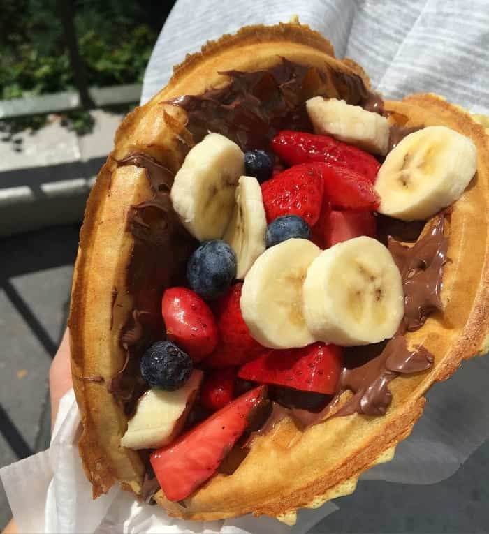 A Waffle Sandwich Filled with Berries, Bananas and Chocolate Hazelnut Spread