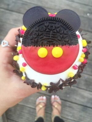 Jenny Holding a Mickey Mouse Cupcake While Wearing a Mickey Ring