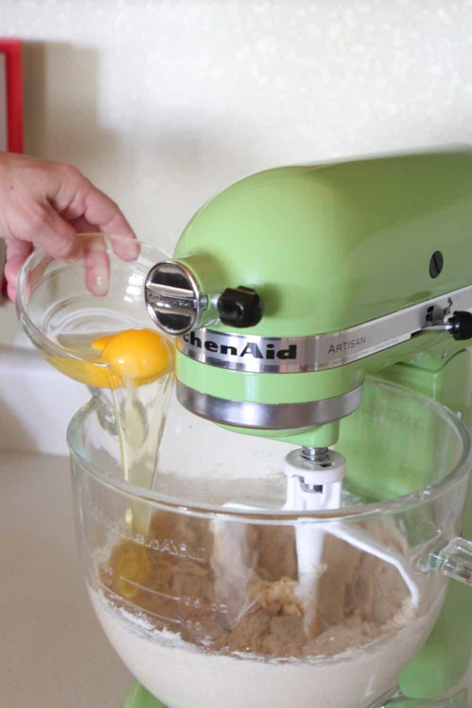 adding eggs to lemon cookies recipe