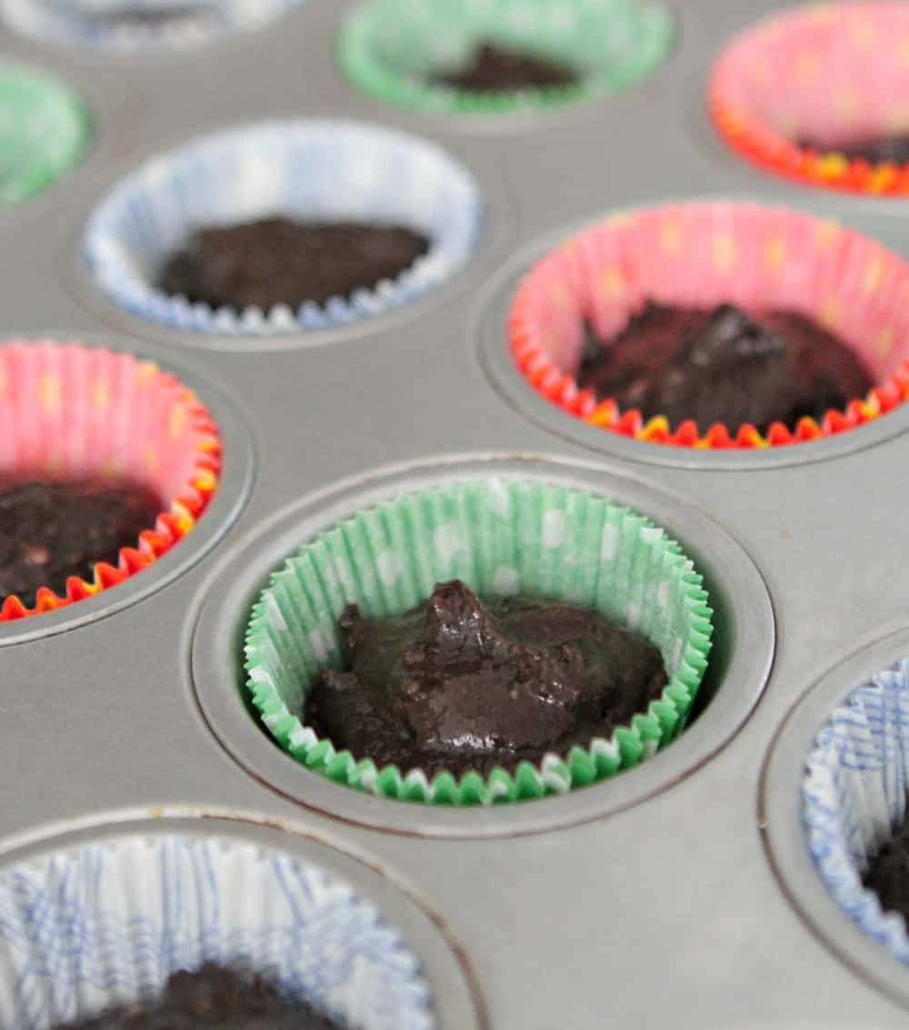 pumpkin cupcake batter in muffin tins