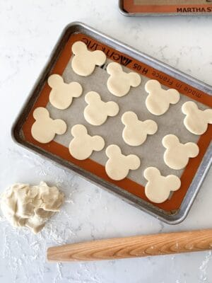 mickey mouse sugar cookies on baking sheet