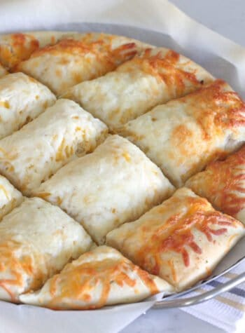 cheesy pizza bread cut into squares