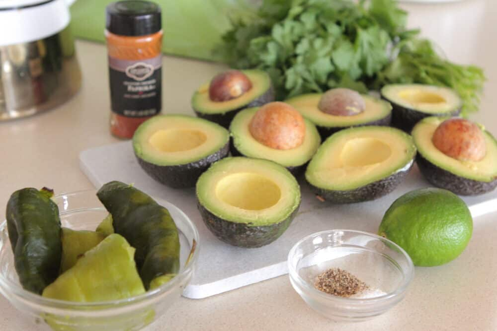 halved avocados and seasonings
