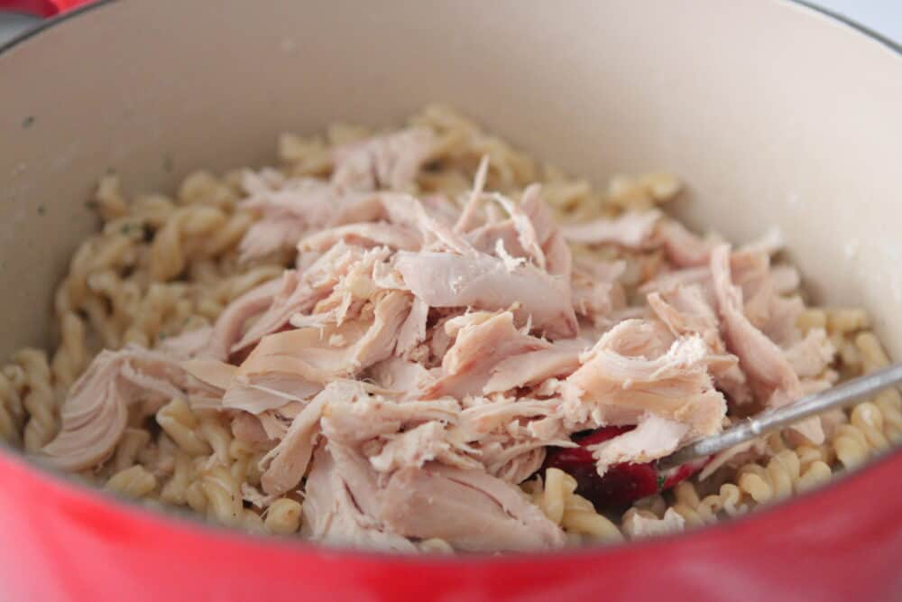 cooked chicken added to pot