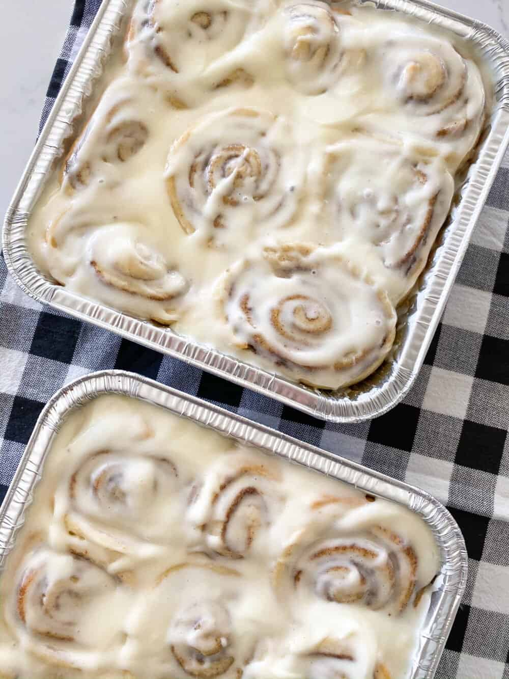 homemade cinnamon rolls in baking trays