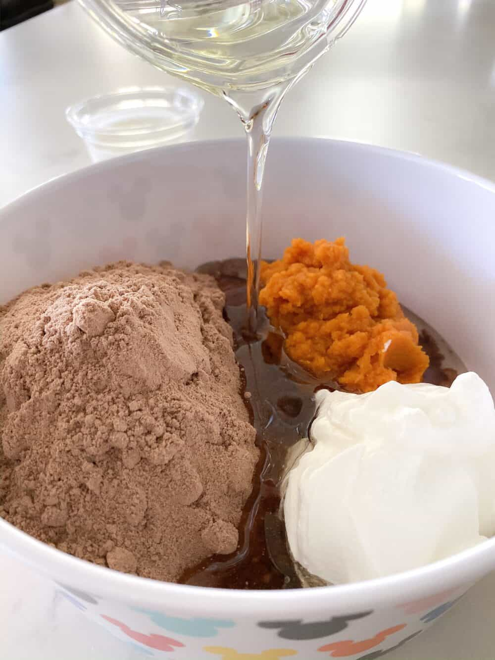 ingredients in mixing bowl for chocolate bundt cake